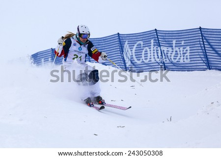 CALGARY CANADA JAN  3  2015.  FIS Freestyle Ski World Cup, Winsport, Calgary Ms. K.C. Oakley  from USA  at the Mogul Free Style World Cup on race day.  - stock photo