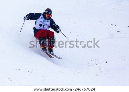 "CALGARY CANADA JAN 2 2015. FIS Freestyle Ski World Cup, Winsport, Calgary  Unidentified ""T4"" Pre Runner from Canada at the Mogul Free Style World Cup on practice day.  - stock photo"