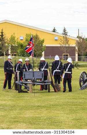 CALGARY, CANADA - JUN 13: Exhibits outside the Military Museums in Calgary, Alberta Canada. It is made of museums dedicated to representing Canada's navy, army, and air force. Soldiers with cannon.  - stock photo