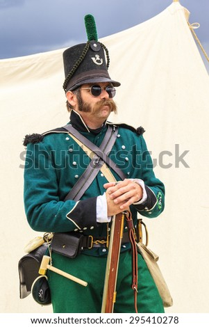 "CALGARY CANADA JUN 13 2015:  The Military Museum organized ""Summer Skirmish"" event where an unidentified soldier is seen  in a historical Reenactment Battle.  - stock photo"