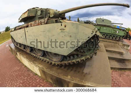 """CALGARY CANADA JUN 13 2015: The Military Museum organized """"Summer Skirmish"""" event where an unidentified soldier is seen in a historical Reenactment Battle. Centurion battle tank on display. - stock photo"""
