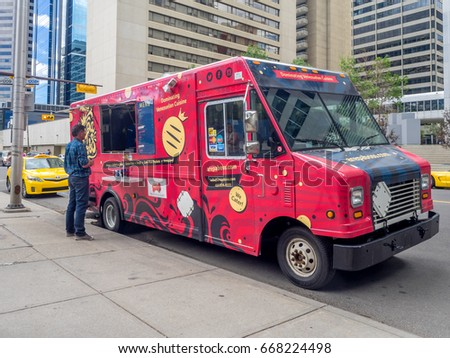 CALGARY, CANADA - JUNE 23: A gourmet food truck on June 23, 2017 in Calgary, Alberta. Food trucks have become very popular in Calgary's urban financial district and serve up fast food daily.