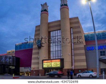 CALGARY, CANADA - JUNE 3: Cineplex movie theatre at Chinook Centre mall at sunset on June 3, 2016 in Calgary, Alberta Canada. Chinook mall is one of the busiest malls in Alberta and Canada. - stock photo
