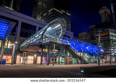 CALGARY, CANADA - MAR 13: C-Train transit station at night on March 13, 2016 in Calgary, Alberta, Canada. The C-Train is Calgary's main rabid transit commuter alternative.