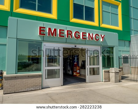 CALGARY, CANADA - MAY 24: Entrance and exterior of the Emergency wing of the Alberta Children's Hospital on May 24, 2015 in Calgary, Alberta. It is a modern up to date health centre for Children only. - stock photo