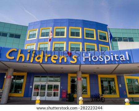CALGARY, CANADA - MAY 24: Entrance and front exterior of the new Alberta Children's Hospital on May 24, 2015 in Calgary, Alberta. It is a modern up to date health centre for Children only. - stock photo