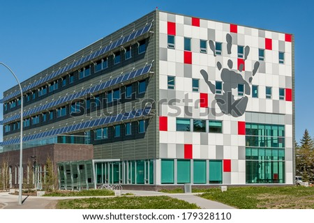 CALGARY, CANADA - MAY 15: Modern building utilizing the environmental technology on May 15, 2008 in Calgary, Alberta. The Solar panels provide energy for electricity and shade over the windows.
