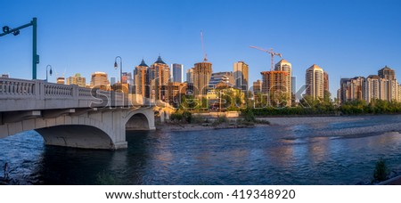 CALGARY, CANADA - MAY 7: Panorama of Calgary's skyline along the Louise Bridge on May 7, 2016 in Calgary, Alberta. The Louise Bridge connects Kensington with downtown Calgary over the Bow River.