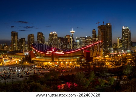 CALGARY, CANADA - MAY 23: Sunset over Calgary's skyline with the Scotiabank Saddledome in the foreground May 23, 2015. The dome is home to the Calgary Flames NHL club and Lacrosse's Roughnecks. - stock photo
