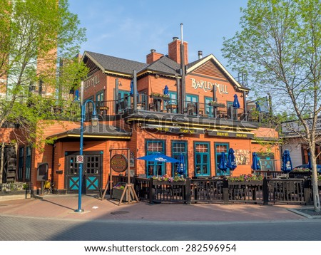 CALGARY, CANADA - MAY 24: The Barely Mill Pub on May 24, 2015 in Calgary, Alberta Canada. The Barely Mill is housed in an historic lumber company building in Calgary's Eau Claire Market district. - stock photo