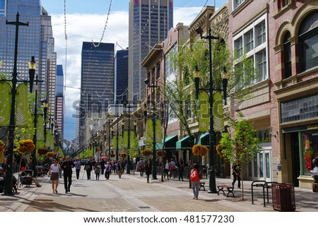 CALGARY, CANADA - MAY 26: Tourists stroll along historic Stephen Avenue in downtown Calgary on May 26, 2016. Calgary, Alberta, Canada