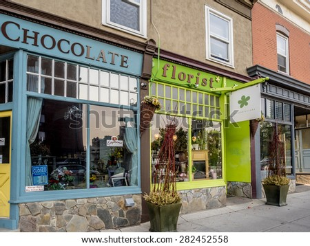 CALGARY, CANADA - MAY 24: Trendy boutiques in the 17th Ave district on May 24, 2015 in Calgary, Alberta Canada. Calgary's 17th Ave district is a trendy and urban part of Calgary's inner city. - stock photo