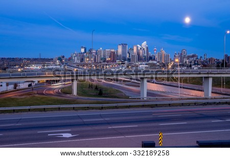 CALGARY, CANADA - OCT 25: Skyscrapers tower over urban freeways in the city of Calgary on October 25, 2015. This view is looking towards the east and Crowchild Trail is visible in the foreground.