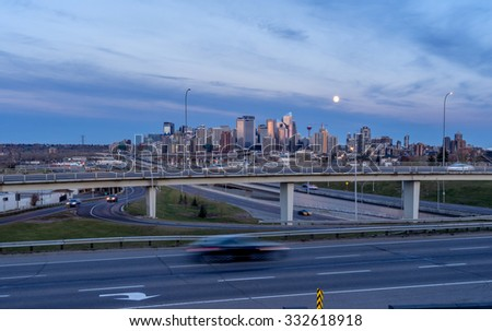 CALGARY, CANADA - OCT 25: Skyscrapers tower over urban freeways in the city of Calgary on October 25, 2015. This view is looking towards the east and Crowchild Trail is visible in the foreground. - stock photo