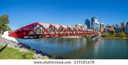 CALGARY, CANADA - SEPT 21: Panorama of the Peace Bridge on September 21, 2014 in Calgary, Alberta Canada. The pedestrian bridge spans the Bow River and was designed by Santiago Calatrava.  - stock photo