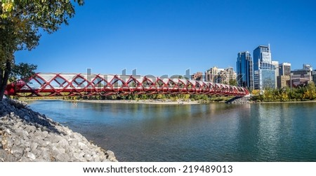 CALGARY, CANADA - SEPT 21: Panorama of the Peace Bridge on September 21, 2014 in Calgary, Alberta Canada. The pedestrian bridge spans the Bow River and was designed by Santiago Calatrava.