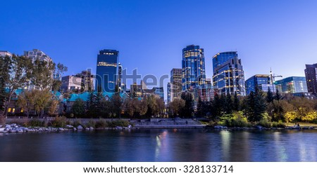 Calgary skyline at night along the Bow River.  - stock photo