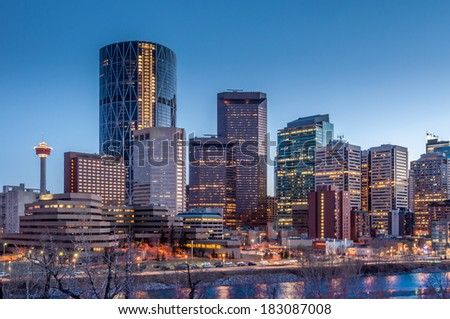 Calgary skyline at night with Bow River. - stock photo