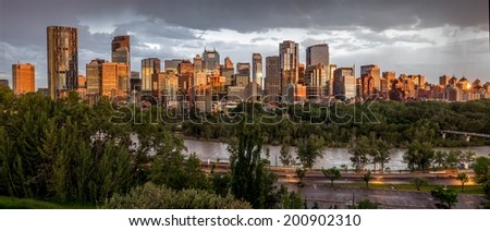 Calgary skyline at night with Bow River - stock photo
