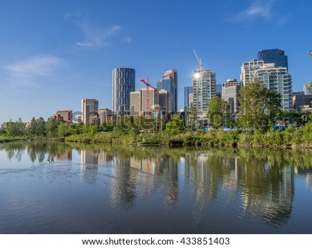 Calgary skyline with Bow River in foreground.
