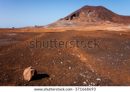 Calhau crater, Cape Verde - Sao Vicente Island. Single  rock, Martian like dry red ground surface