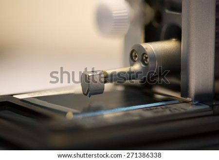 Calibration surface roughness tester machine with gage block - stock photo