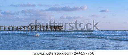 California coast. San Diego beach at sunset. Ocean Waves rolled on the sand - stock photo