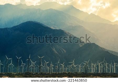 California Desert Wind Turbines in Coachella Valley. Scenic Mountains and Sun Light. California, United States. - stock photo