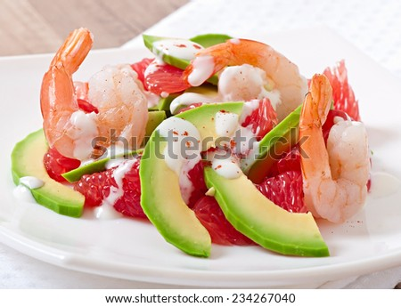 California salad - a mix of avocado, grapefruit and shrimp, seasoned with cayenne pepper yogurt - stock photo