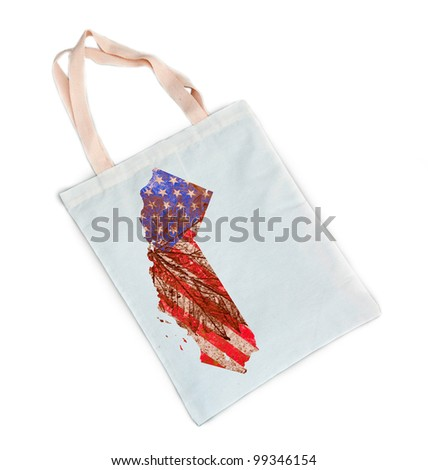 California state of the United States of America in grunge flag pattern on white cotton shopping bag isolated on white background
