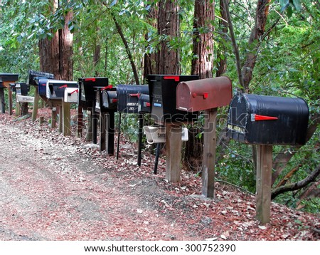 CALIFORNIA STATE ROUTE 236 , CA - NOVEMBER 15, 2012:   Mailboxes Lined Up On Side of Rural Road