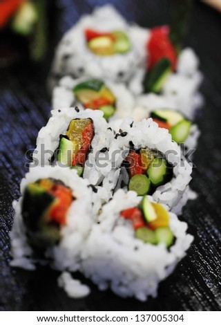 California sushi roll platted on a black plate. - stock photo