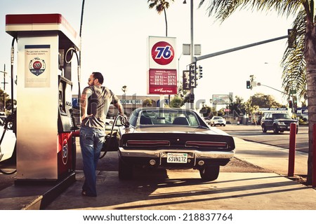 CALIFORNIA, USA - AUGUST 5, 2012: Man filling the car with gasoline in gas stations on August 5, 2012, San Diego, CA, USA - stock photo
