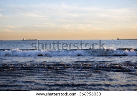California Waves Crashing In The Sunset - stock photo