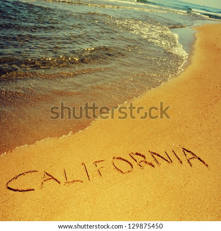 california written on the sand of a beach, with a retro effect - stock photo