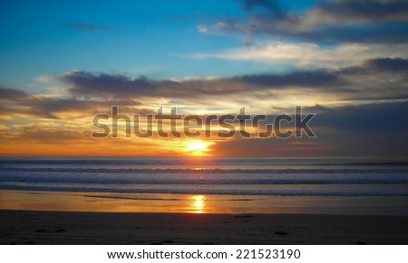 Californian seagull flying at sunset - stock photo