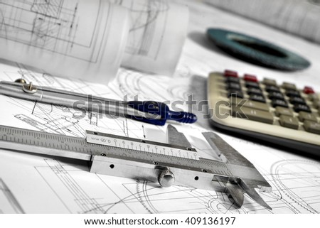caliper , calculator, compasses, grinding disc, and drawings