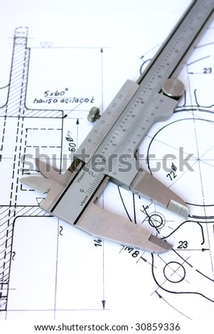 Caliper on technical drawing. Vertical. Shallow Depth of Field - stock photo