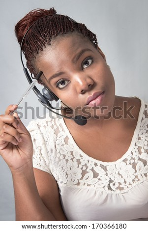 Call Center Agent feeling frustrated while thinking - stock photo