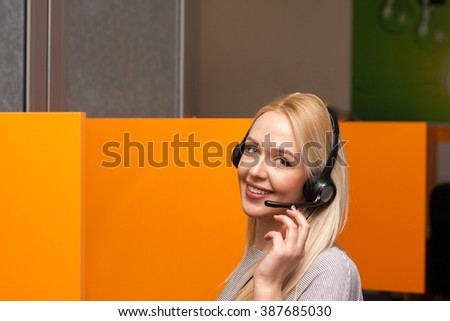Call center agent work in her box office - stock photo