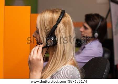Call center agents work in their box office - stock photo