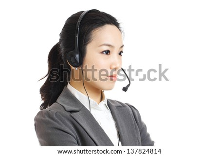 Call center business woman with headset - stock photo