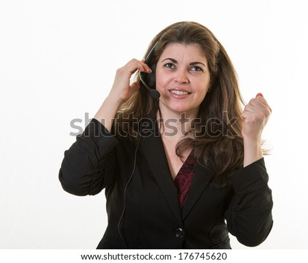 Call center employee frustrated with the guest she is speaking to - stock photo