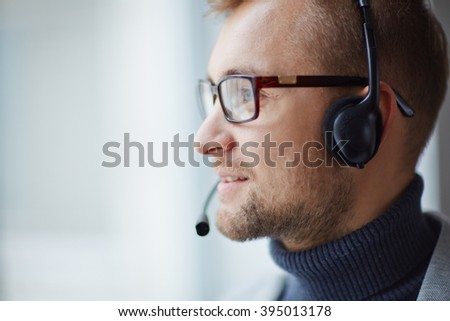 Call center operator man with headsets working - stock photo