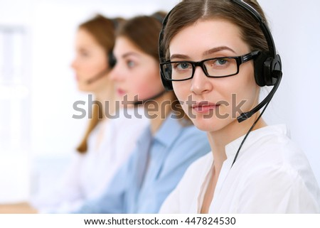 Call center operator.Young beautiful business woman in headset.  - stock photo