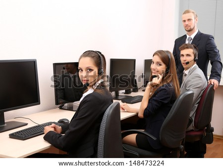 Call center operators at work - stock photo