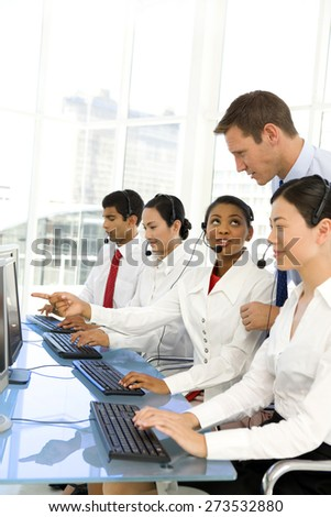 Call center operators. Selective focus. - stock photo