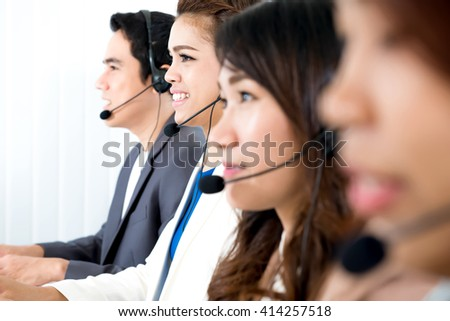 Call center (or telemarketer) team - customer service operator concept
