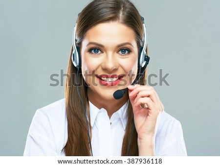 Call center support operator.Close up portrait of woman customer service touching headset. Isolated studio. - stock photo