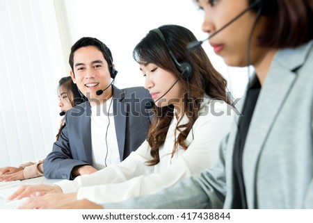 Call center ( telemarketer or operator) team - customer service and support concept - stock photo